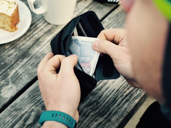 Cyclist Taking Money out of Phone Wallet